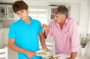 Father making teenage son do housework